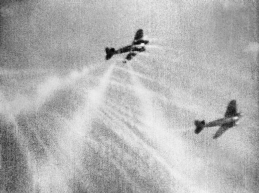 A still from camera gun film shows tracer ammunition from a Supermarine Spitfire Mark I of No. 609 Squadron RAF, flown by Flight Lieutenant J H G McArthur, hitting a Heinkel He 111 on its starboard quarter. These aircraft were part of a large formati