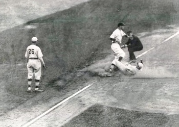 This is reportedly a photo of Medwick's slide into third in Game 7 of the 1934 World Series.
