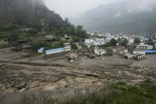 Earthquake flurries and tremors are the cause of most landslides, of course rain helps to loosen the topsoil creating muddy conditions,