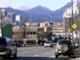 The view of snow-capped mountains as one approaches the city of Vancouver's downtown core from the Mount Pleasant area.