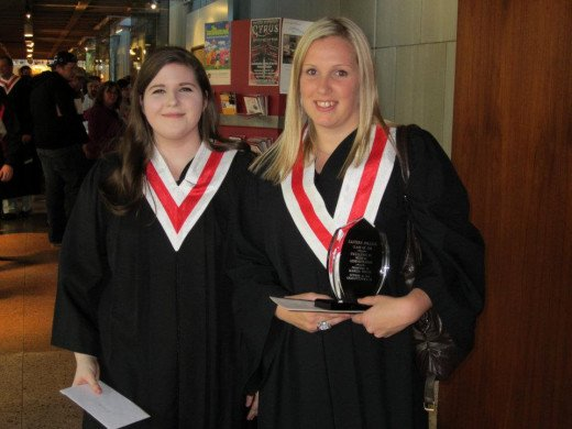 This was taken after graduation nearly a year ago. Her friend is holding her award for her.