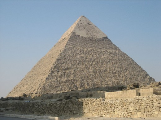 The smooth outer casing of polished limestone that once covered all three of the Great Pyramids can still be seen at the top of Khafre's Pyramid.