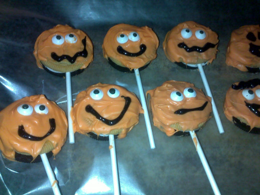 use candy eyes or decorating icing to put faces on the pops