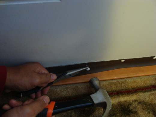 Fig 4.  Hammering Small Nails into Door Bottom and Door