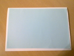Paste the blue paper over the white card