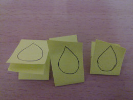Fold the rectangle paper into halves and draw the flames. Cut them out.