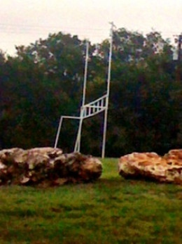 A local church football field uses large rocks for its borders. They provide a great place to sit and watch the games as well as a natural border so that cars do not drive into the area.