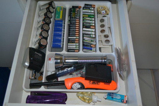 Our silverware drawer organizer neatly arranges my batteries by type