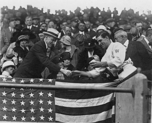 Washington manager Bucky Harris presents President Calvin Coolidge with the baseball used to open the 1924 World Series