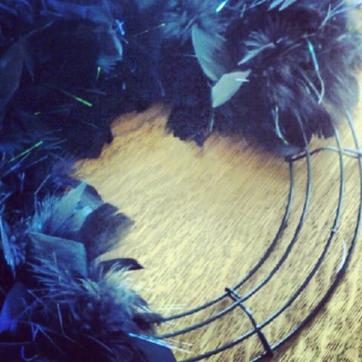 Feather boa around wreath