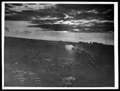 WW1: Field gun firing at dawn.