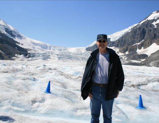 Don standing on the Glacier, note the blue cone warnings for a possible crevasse.