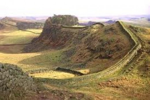 Hadrian's Wall landscape - undularing rolling hills of the Cheviots south of the border with Scotland. Views north to Kielder wildlife park in the distance