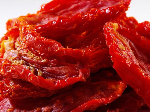 Homemade dried tomatoes are delicious and can be done by slow roasting in a conventional over on a low heat setting with the door slightly ajar.