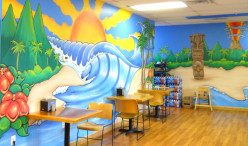Beach themed murals cover the interior walls.