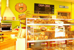 Appetizing display cases filled with bagels and pastries.