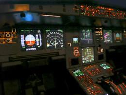 The flight deck instrument panel lit up at night