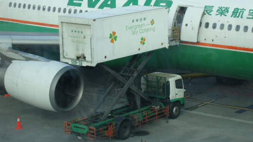 While food for people is being loaded, the airplane's fuel tanks are also refilled.