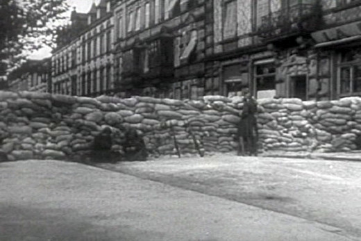 French troops setting barricades in Paris in case of an upcoming Nazi German invasion (May 1940). Screenhot taken from the 1943 United States Army propaganda film Divide and Conquer (Why We Fight #3) directed by Frank Capra and partially based on, ne