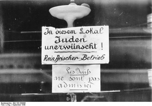 Sign in a shop window informing passers by that Jews are not allowed