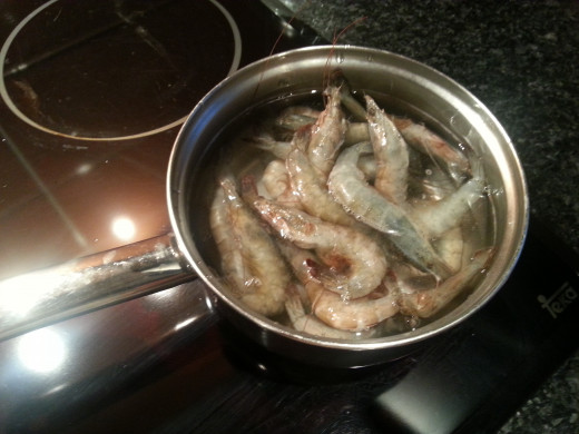 Once it starts boiling add the shrimps