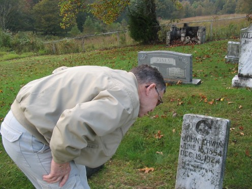 Reading a tombstone.
