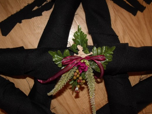 I tied down faux plants and purple ribbon, then hot glued it down to secure.