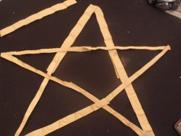Cut strips, form a 5 point star and glue together.