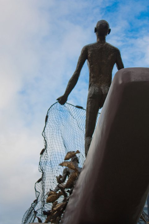 Pasasalamat, along Rizal Drive, is Ferdie Cacnio's brass representation of two fishermen's humble expression of gratitude to the Almighty for a bountiful harvest.