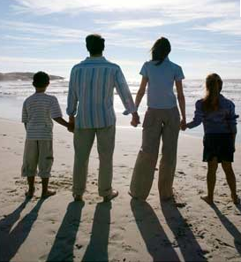 A beautiful family photo that represents the family and their personalities. It makes you feel they love the beach and makes you feel warm and lovely looking at it.
