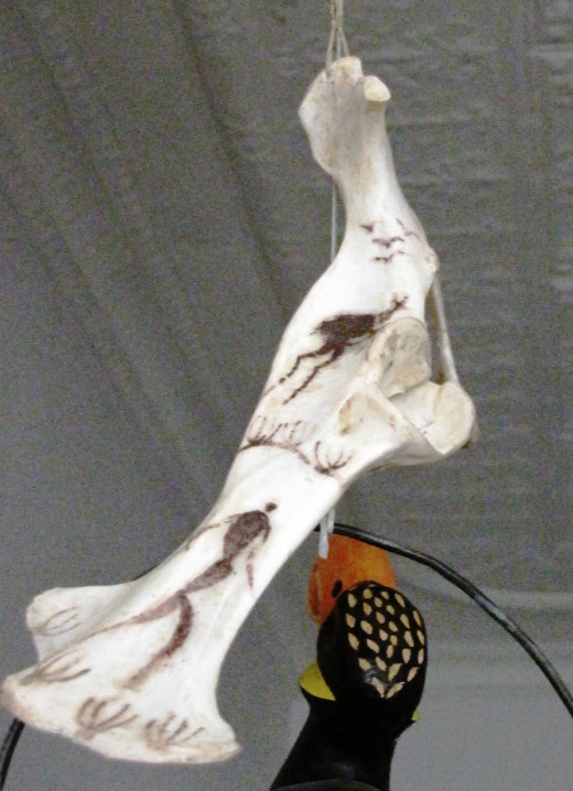 Springbuck Thighbone and Bushman painting