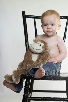 Monkey Boy by Beatricekillam  Image of a cute toddler sitting on a black chair, holding a stuffed monkey
