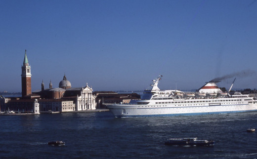 Cruise ship sailing by Doges Palace - Venice, Italy