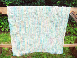 Cyndi Calhoun knitted this beautiful baby blanket ~ very nice!  Check out her Pictimilitude website.