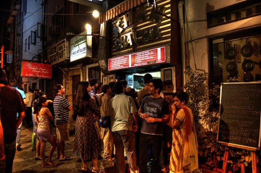 People standing in queue late night waiting for their favorite meals at Khan Chacha's Kebab Corner in Khan Market.