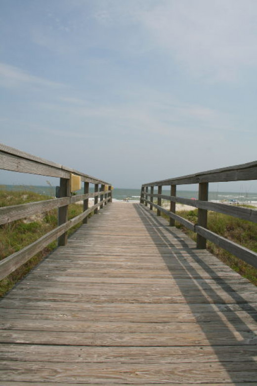 Use a depth of field technique for photos at the beach with a boardwalk. Stage the family at various spots.