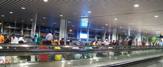 Waiting for the late, late plane at Kuala Lumpur International airport. People plopped down anywhere they could. The lounge was closed till the plane landed.