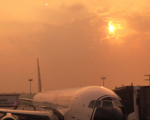 Dramatic sunset at Dhaka airport. That's a Blue Panorama Airlines plane that we were waiting to board.
