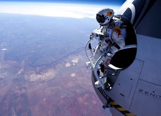 Felix Baumgartner, stepping into the void from 71,580 feet during a test jump in March. The Austrian adventurer plans a record-setting jump from 120,000 feet on Tuesday. Photo: Jay Nemeth/