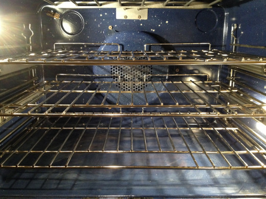 To use the automatic feature to clean oven, shelves and vertical wall racks must be lifted out.