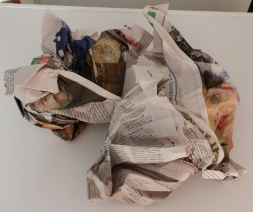 Crumple up some sheets of newspaper