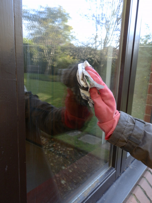 Wipe off the wet window surface using dry crumpled newspaper