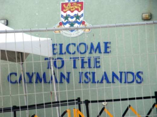 A Welcome To The Cayman Island. This sign was actually hidden from view. I had to go around a barricade to take this snap.  Image Is Property of ComfortB. Use by permission only.