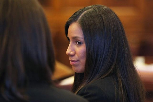 Alexis in court at her arraignment, Oct.2012