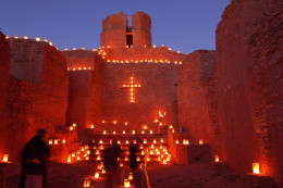 Luminarias outline the old church at the Jemez Monument, New Mexico