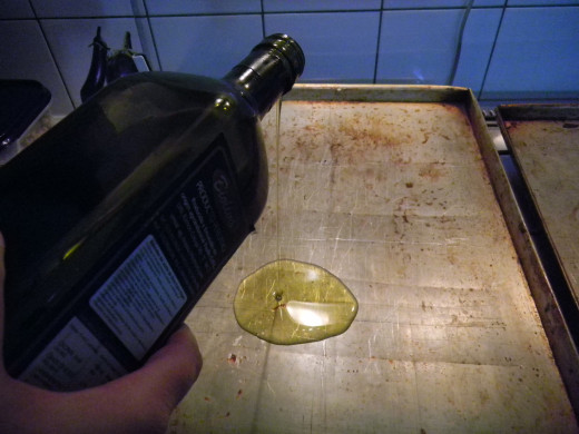 pour a decent amount of olive oil onto a baking sheet