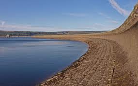 Kielder Dam wall - being an artificially formed lake, a dam holds the water back otherwise the valley would revert to a river course