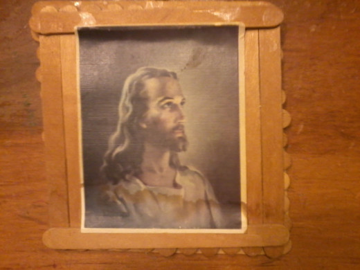 Popsicle frame and picture of the Lord I made when I was a small child in Vacation Bible School.