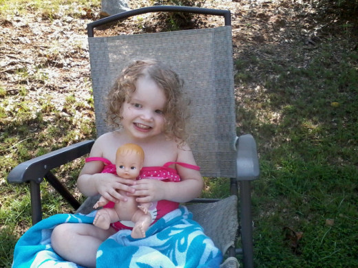 My youngest granddaughter, Lily, 2 1/2 years old, all wet from swimming holding on tight to her babydoll.