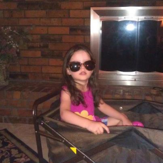 My oldest granddaughter, Scarlett, being dramatic at 4 1/2 years old.  LOL, she just really cracks me up!